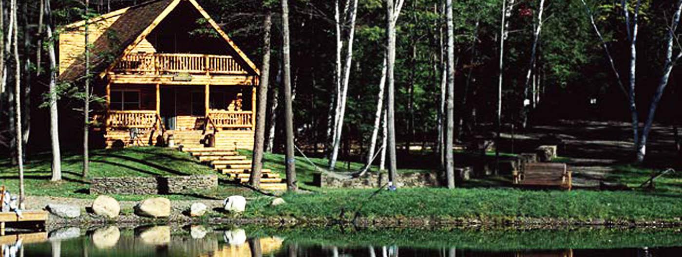 Log cabin on lake