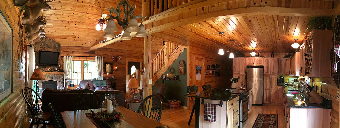 Open floor plan for log home - kitchen, dining and living room